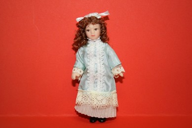 Porzellan-Biegepuppe - kl. Mädchen m. lindgrünem Kleid