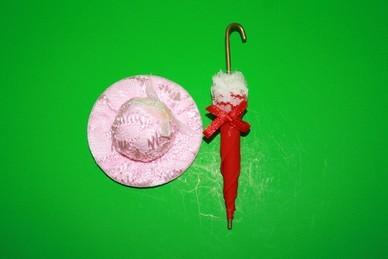 Hut rosa und Schirm rot