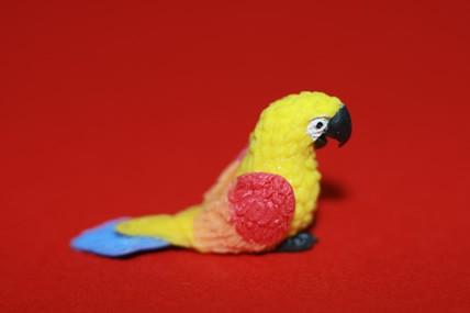 Papagei klein, gelb/rot/orange