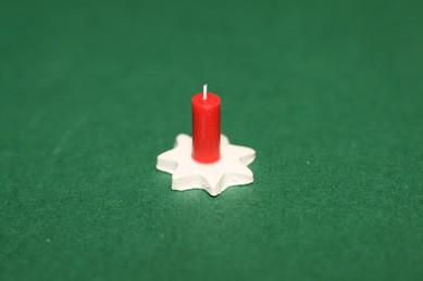 Kerze auf Stern-Untersetzer